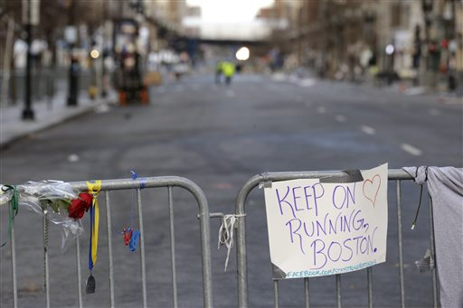 A sign hangs from a barricade on Boylston Street near the finish line of the Boston Marathon on Wednesday as the city continues to cope following Monday's explosions near the finish line of the marathon.