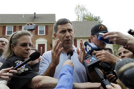 Ruslan Tsarni, the uncle of the Boston Marathon bombing suspect, speaks with the media outside his home in Montgomery Village in Md. on Friday.