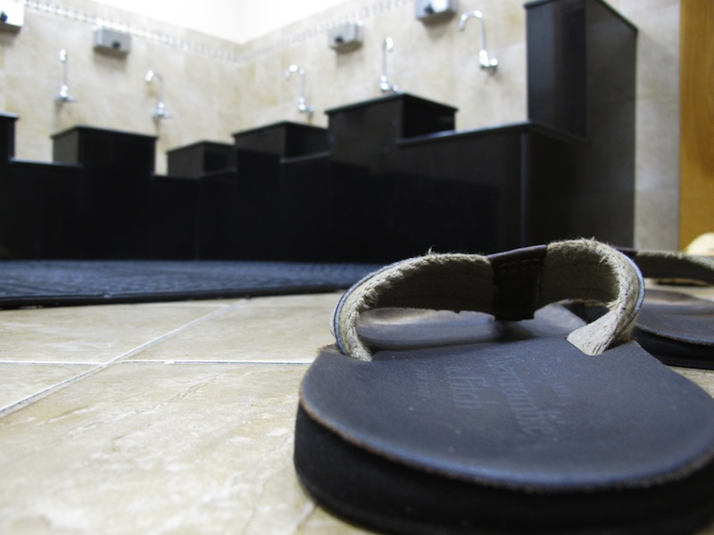 A pair of sandals sits on the floor in the washroom at the Islamic Society of Boston mosque in Cambridge, Mass., on Friday, April 19, 2013. A mosque official confirmed that the two suspects in the Boston Marathon bombings, who lived a short distance away, worshipped there occasionally. Tamerlan Tsarnaev ranted at a neighbor about Islam and the United States. His younger brother, Dzhokhar, relished debating people on religion,