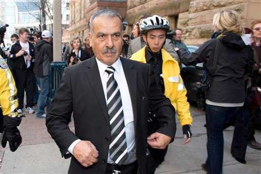 Mohammed Jaser, father of Raed Jaser, leaves court in Toronto on Tuesday. Raed Jaser is accused with another man of plotting to derail a train in Canada with support from al-Qaida elements in Iran.