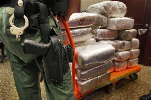 Bales of marijuana are wheeled out at a news conference in Jonesboro, Ga., in 2010, when 45 people were arrested and cash, guns and more than two tons of drugs were seized as part of an investigation by federal and local law enforcement into the Atlanta-area U.S. distribution hub of Mexico's La Familia drug cartel.