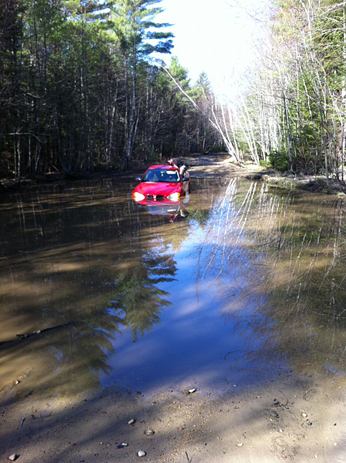 This photo provided by Lebanon Rescue shows the 2005 Pontiac Grand Am that got stuck Friday in a flooded section of Lord Road, which becomes impassable every spring.