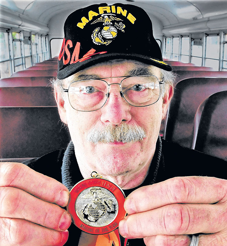 Richard Gordon of Norridgewock holds the medal he received for being named Maine Marine Corps League Marine of the Year.