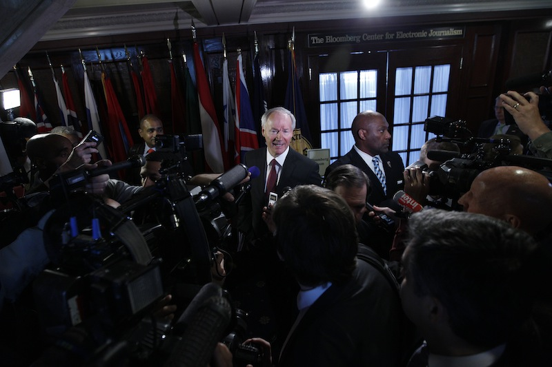 National School Shield Task Force Director, former Arkansas Rep. Asa Hutchinson speaks with reporters after a news conference at National Press Club in Washington on Tuesday. The National School Shield program is a framework to arm security guards in any school system who want to be part of the program.