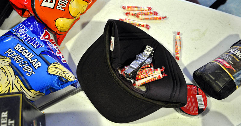 Christopher Knight was arrested at Pine Tree Camp in Rome carrying candy, potato chips, a ball cap, poncho and a wristwatch that were all allegedly stolen from the camp.