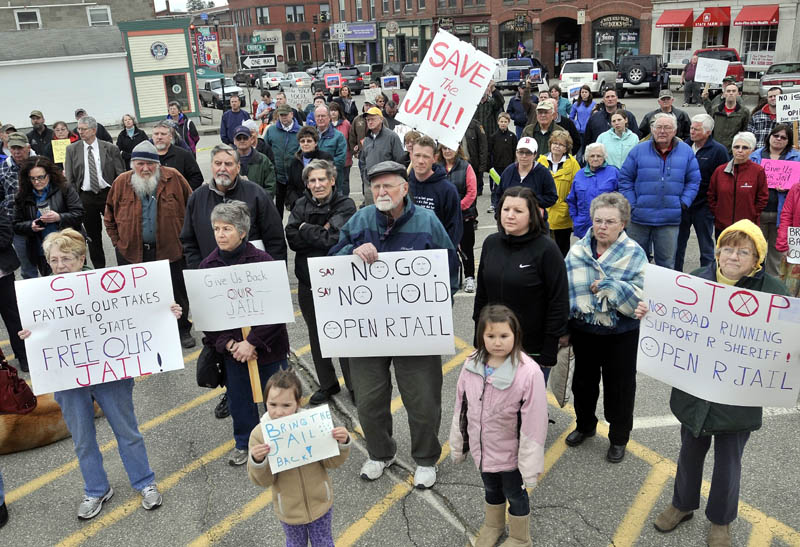 Protesters in Farmington listen to Sheriff Scott Nichols, Sr., speak during a protest Wednesday at the Franklin County Courthouse over the Franklin County Jail's reduction to a 72-hour holding facility.