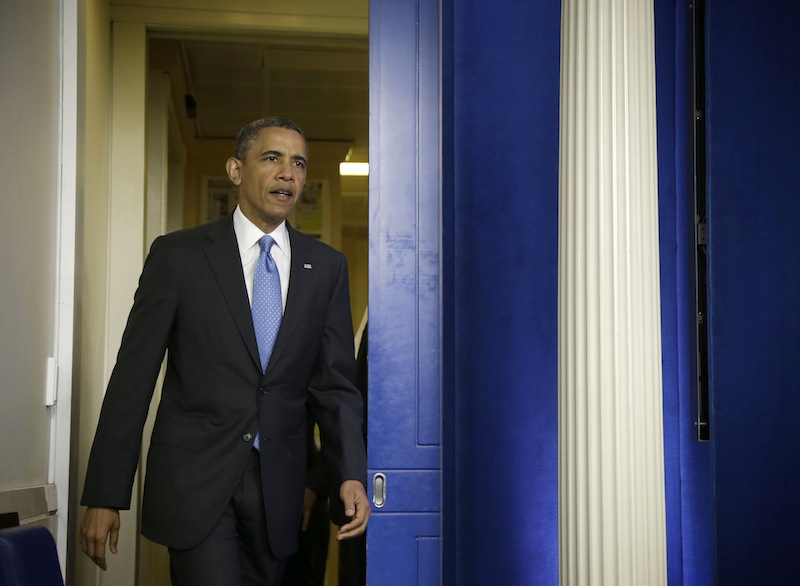 President Barack Obama arrives for a new conference in the Brady Press Briefing Room of the White House in Washington, Tuesday, April 30, 2013. (AP Photo/Evan Vucci)
