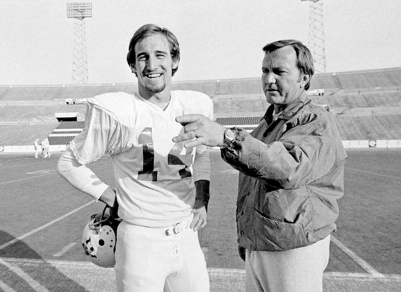 In this Dec. 15, 1976 file photo, New England Patriots Coach Chuck Fairbanks, right, makes a point as he discusses play with quarterback Steve Grogan, during a workout at Schaefer Stadium in Foxborough, Mass., as they prepared for playoff game against the Oakland Raiders. Fairbanks, who coached Heisman Trophy winner Steve Owens at Oklahoma and spent six seasons as coach of the New England Patriots, died Tuesday, April 2, 2013, in Scottsdale, Ariz., after battling brain cancer, the University of Oklahoma said in a news release. He was 79. (AP Photo/File) Coah;Football;Gesturing;Player;Professsional;Quarterback;Stadium;Talking