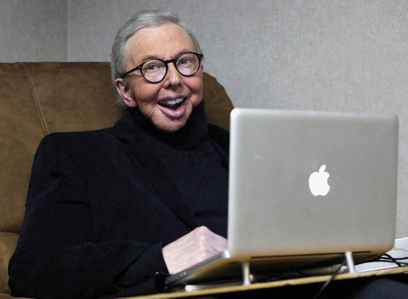 In this Jan. 12, 2011 file photo, Pulitzer Prize-winning movie critic Roger Ebert works in his office at the WTTW-TV studios in Chicago. In an essay posted Tuesday, April 2, 2013, Ebert says that he has cancer again and is scaling back his movie reviews while undergoing radiation. The veteran critic has previously battled cancer in his thyroid and salivary glands and lost the ability to speak and eat after surgery. (AP Photo/Charles Rex Arbogast, File)