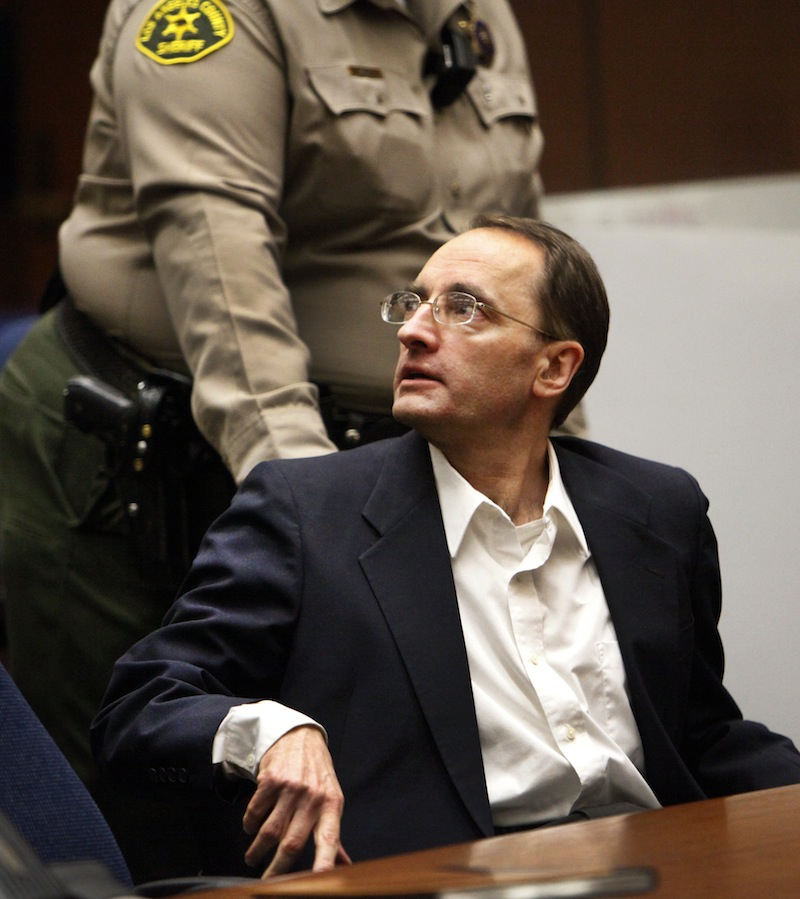 Christian Gerhartsreiter is led away by a Sheriff's deputy in a Los Angeles Superior Courtroom after a jury delivered a guilty verdict on April 10, 2013 in Los Angeles. The jury found Gerhartsreiter guilty in the death of a California man nearly three decades ago. The verdict was reached Wednesday after the jury deliberated about a day. Testimony in the cold-case trial of Gerhartsreiter focused on the discovery of the bones of John Sohus long after he and his wife disappeared from his mother's home in San Marino, a wealthy Los Angeles suburb. The defendant, a German immigrant with delusions of grandeur, rented a cottage at the Sohus home in 1985 then disappeared about the same time as Sohus and his wife Linda who was never found. (AP Photo/Los Angeles Times, Al Seib)