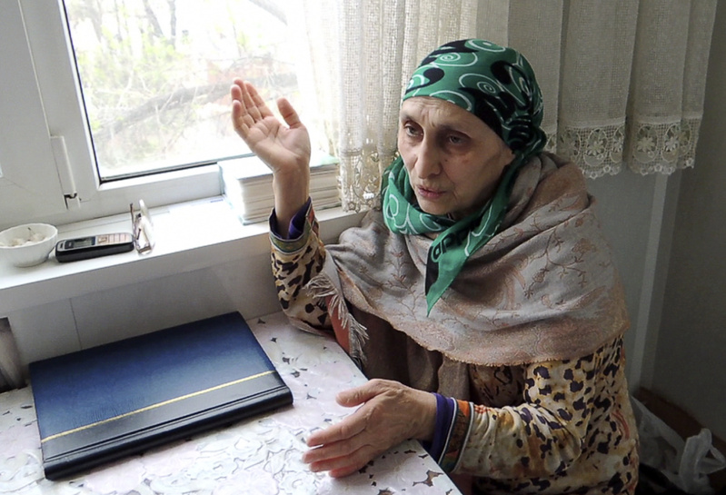 In this image taken from a video, Patimat Suleimanova, the aunt of the Boston Marathon bombing suspects, speaks in her home in the Russian city of Makhachkala about her nephew, Tamerlan Tsarnaev, on Monday.