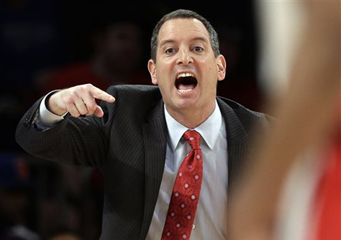 In this March 12, 2013, photo, Rutgers coach Mike Rice yells out to his team during a game against DePaul in the Big East tournament in New York.