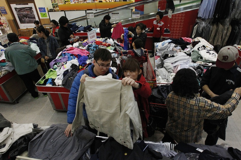 Customers choose clothes at a Lotte Mart in Seoul, South Korea, on Friday. Outsiders might hear the opening notes of a war in the deluge of threats and provocations from North Korea, but to South Koreans it is a familiar song.