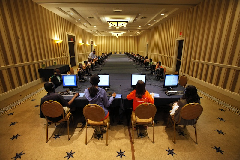 In this May 29, 2012 file photo, contestants in the National Spelling Bee take the written exam on computers in Oxon Hill, Md., before the oral competition began. Ever wonder if those spelling bee kids know the meanings of some of those big words? Now they'll have to prove that they do. Organizers of the Scripps National Spelling Bee on Tuesday announced a major change to the format, adding multiple-choice vocabulary tests to the annual competition that crowns the English language's spelling champ. (AP Photo/Jacquelyn Martin, File)