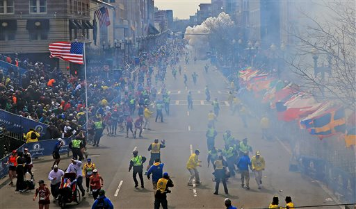 People react as an explosion goes off near the finish line of the 2013 Boston Marathon in Boston on Monday. Event after nail-biting event, America was rocked this week, in rare and frightening ways, with what felt like an unremitting series of tragedies.