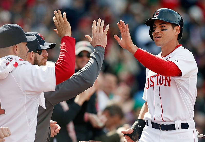 Jacoby Ellsbury, right, celebrates after scoring on an RBI single by David Ortiz in the sixth inning Saturday at Fenway Park.
