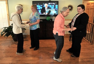 Martha Fabian, far left, dances with Debi Braun alongside June Meres and Maribeth Beland, far right, in the day room at Bedside Manor on Belgrade Road in Oakland. Fabian and Meres are residents at the 10-bed Alzheimer's care facility operated by Fabian's son, E.J. Fabian, and her daughter, Julie Benecke.