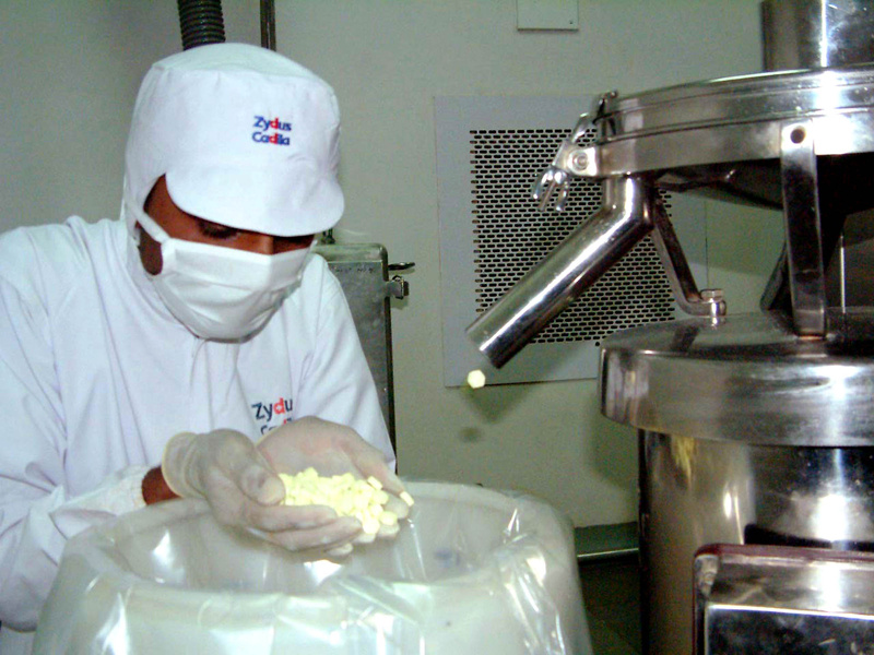 A technician at a manufacturing plan in India inspects a handful of antibiotics during production. A government study finds antibiotics being prescribed at an alarming rate, raising the potential for the drugs to become ineffective.