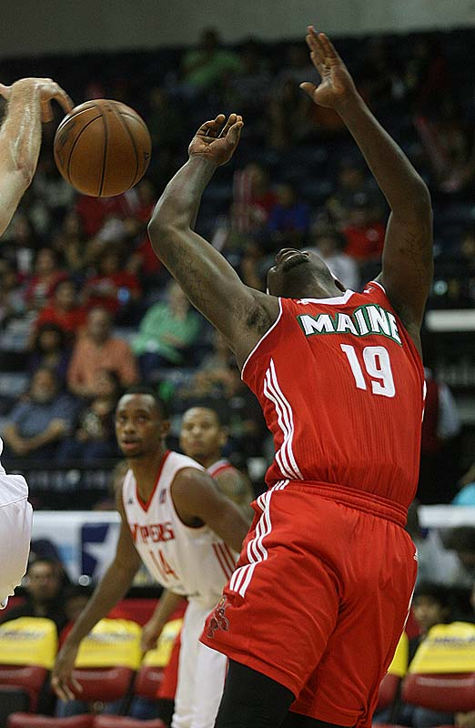 Maine Red Claws' Josh Selby reacts after being blocked by Rio Grande Valley Vipers' Tim Ohlbrecht in Saturday night's NBA D-League playoff game Hidalgo, Texas.