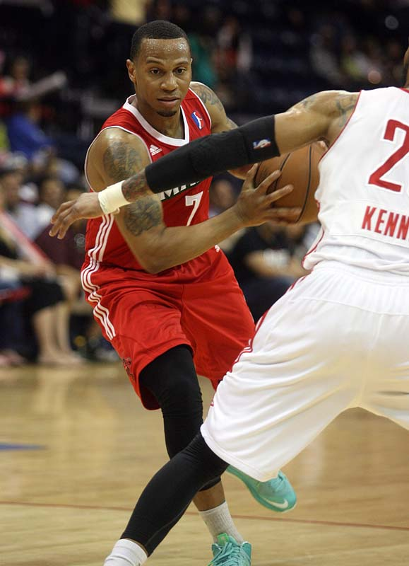 Curtis Jerrells of the Red Claws passes the ball against Rio Grande Valley's DJ Kennedy in Saturday's playoff game.