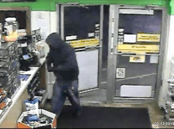 This image from a surveillance camera shows the suspect in Monday's robbery of the Big Apple store on Cottage Road in South Portland.