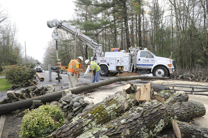 In this Oct. 30, 2012, a FairPoint crew replaces a utility pole in Westbrook after Hurricane Sandy rolled through Maine and caused widespread power outages.