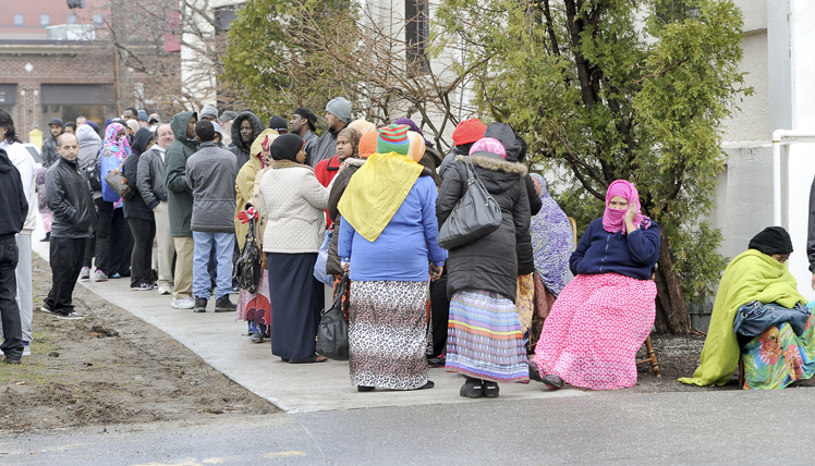 Hundreds of people line up at the Portland Housing Authority on Baxter Boulevard on Wednesday morning. Some waited in line 24 hours because the authority opened its Section 8 waiting list for the first time in three years.
