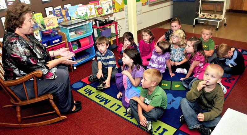 (FILE) Solon Elementary School Principal Jean Butler with kindergarten students.