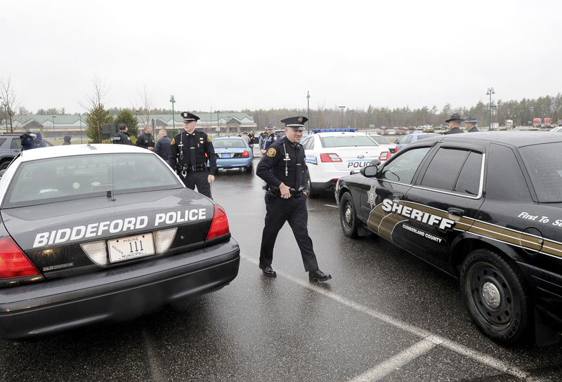 Police officers from across Maine assemble at Cabela's in Scarborough Wednesday, April 24, 2013 for the drive to Boston to honor Sean Collier, an officer at MIT, who was shot by one of the marathon bombing suspects.