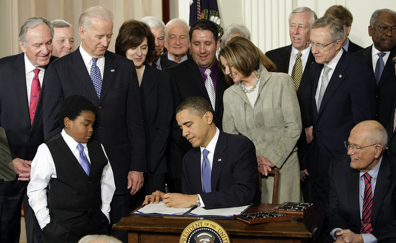 Barack Obama signs the Affordable Care Act into law March 23, 2010 in this file photo. The law requires people to pay back part of a subsidy if their income estimation is off.