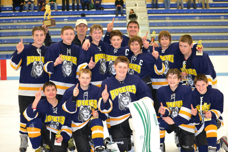 Members of the Huskies Blues bantam hockey team, which recently won the Casco Bay Hockey Tournament in Biddeford: Front (from left to right) – Elijah Gosselin, Darren Puckett, Kyle McKay, Doug Brooks and Jacob Picard; middle – Devin Sloan, Anthony Morrison, Sam Jacob, Tom Komulainen, Gage Chenard, Dylan Francoeur and David Redmond; back – Coach Jake Jacob and Chris Lekousi.