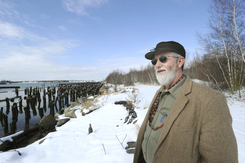 Portland Yacht Services owner Phineas Sprague shows a section of the Portland waterfront where he hopes to build a boatyard. A law protecting trees along the shore shouldn't apply to the growth on this parcel, a reader says.