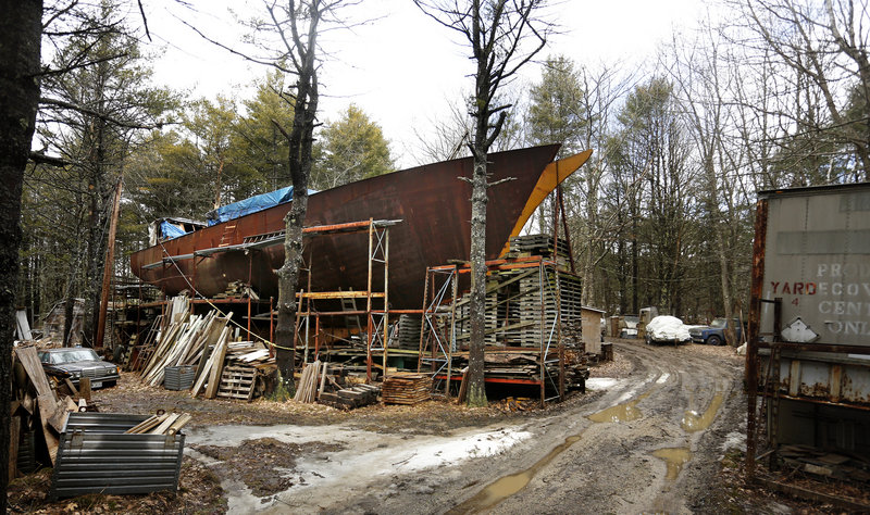 The Island Rover dominates the property of Harold Arndt on Bucknam Road in Freeport. The still-unfinished schooner has been assembled from scrap metal and recycled material.