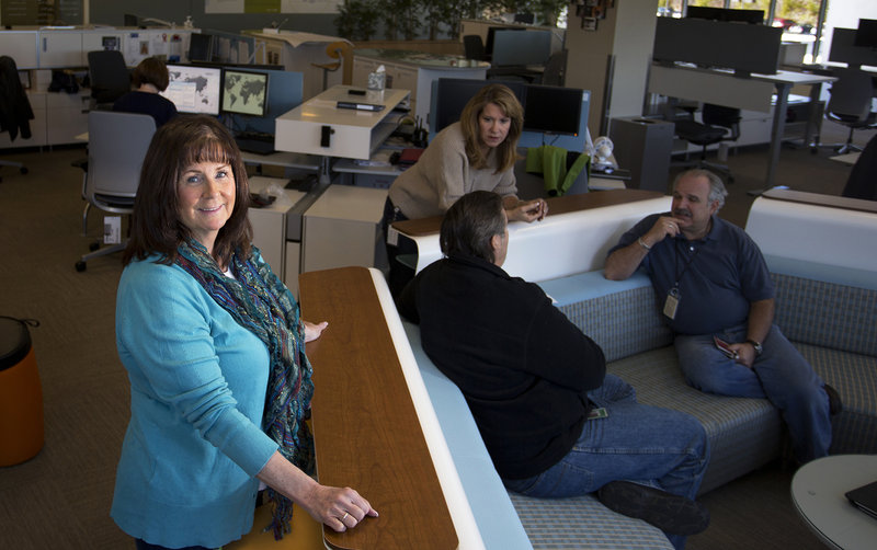Cheryl Morse, senior benefits and wellness manager at Idexx Laboratories in Westbrook, talks about the new health care law in one of the company's collaborative work spaces.