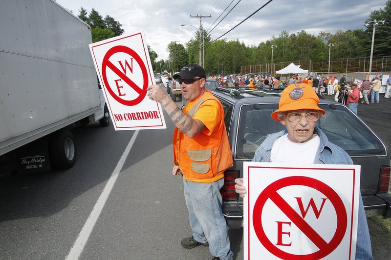 Rob Borden and Erla St. Pierre, both of Wellington, protest in Dover-Foxcroft last May 31 before a public meeting on the proposed east-west highway. A reader cites northern Maine as an area that has maintained its character after Interstate 95 was built there.