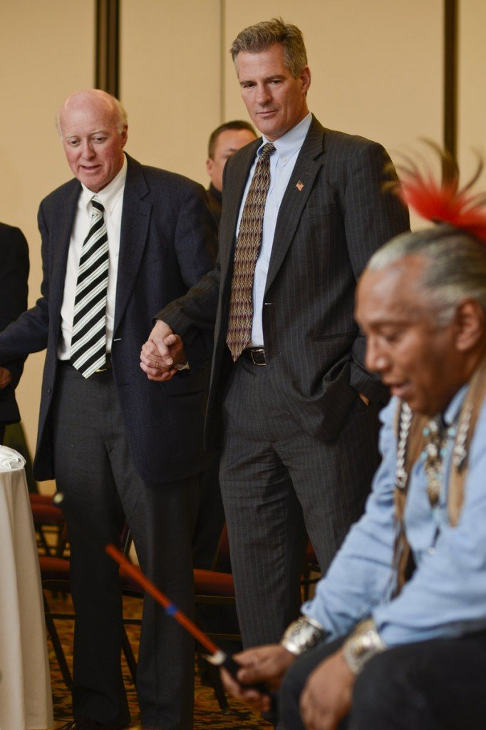 Former U.S. Sen. Scott Brown of Massachusetts watches a traditional drum ritual of the Pequot tribe during the 11th Annual