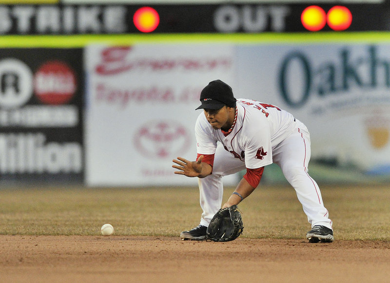 Second baseman Heiker Meneses of the Portland Sea Dogs gets low Friday night to field a grounder during the fourth inning of the game against the Trenton Thunder at Hadlock Field. The Sea Dogs won, 7-4.