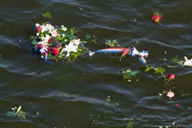 One of three wreaths thrown by family members of USS Thresher crew members floats in Portsmouth Harbor as part of the 50th anniversary memorial Saturday.