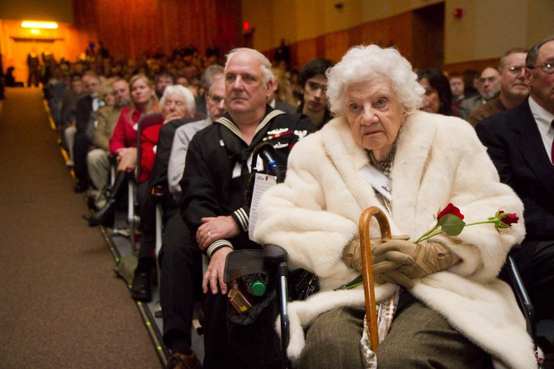 Carolyn Raddatz, right, cousin of a USS Thresher crew member, and her son Michael Raddatz listen during the 50th anniversary memorial ceremony Saturday.