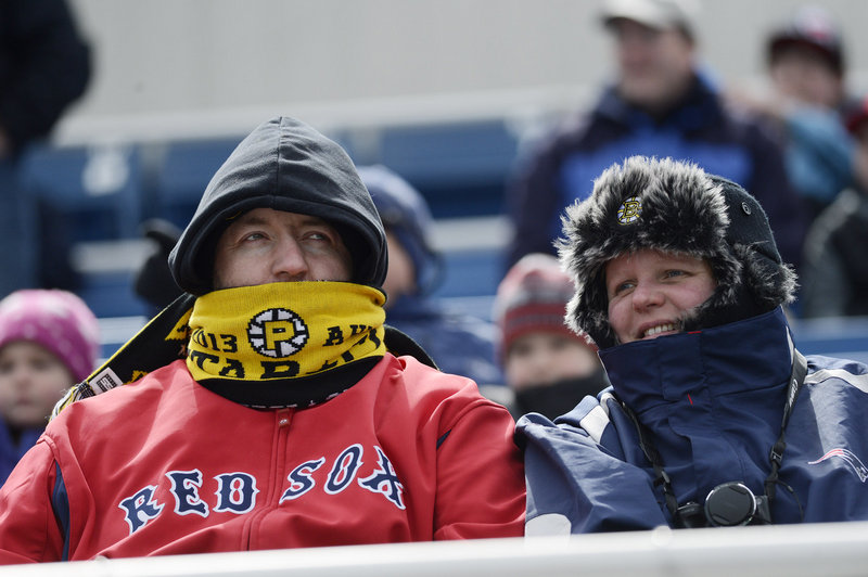 Hats, scarves and warm jackets were wisely donned by David and Vicki Grimbley of Methuen, Mass., as they braved the weather to see the Sea Dogs.