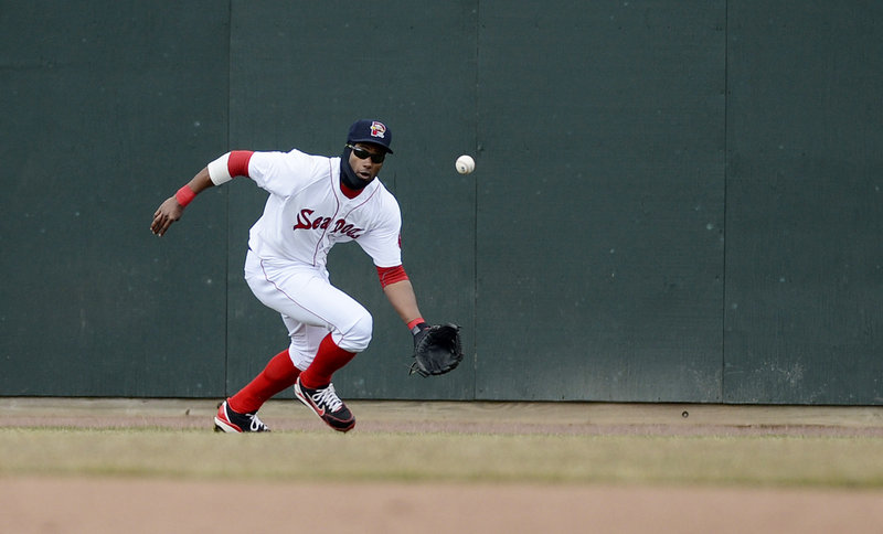 Sea Dogs left-fielder Tony Thomas moves in to field a ball that dropped in for a single during Portland's 9-7 loss to the Trenton Thunder on Sunday. The Sea Dogs hit well, but never led in the game.