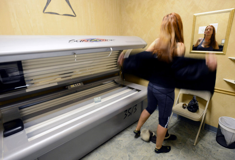 Hillary Cooledge, 28, of Portland prepares to use a tanning bed at Sun Tiki Tanning in Portland last month. People under 25 who use tanning beds have a 75 percent higher risk of melanoma, says the sponsor of a bill barring minors from patronizing tanning salons.
