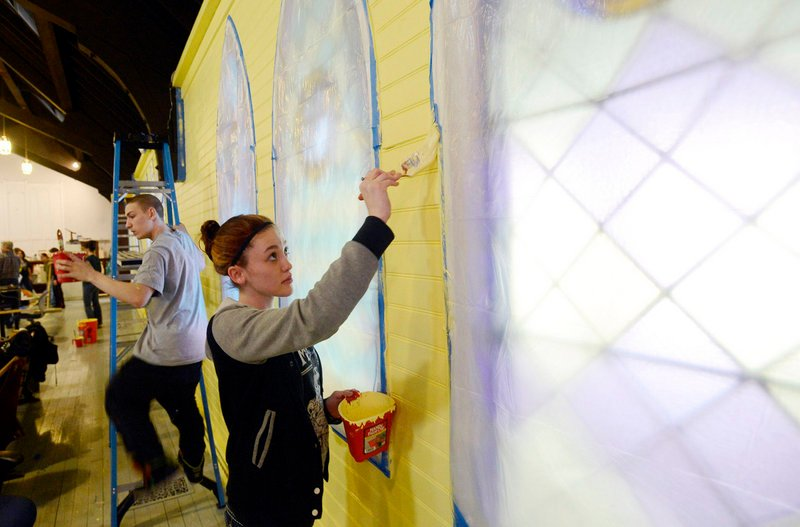 Brooke Riddle, 17, of YouthBuild Biddeford, paints the interior of YouthBuild Biddeford on Tuesday, April 9, 2013.