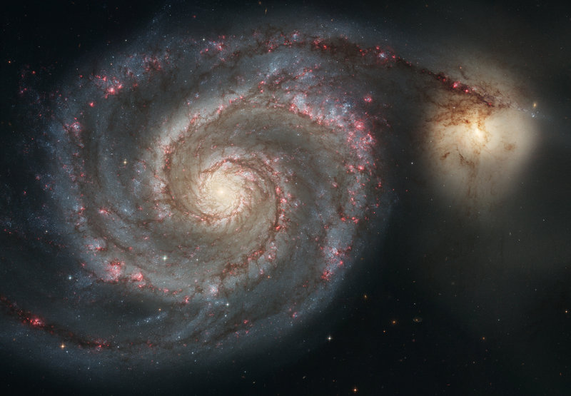 Scientists suspect that dark matter may explain why the arms of this sprial galaxy don't fly out into space. But, so far, none have been able to prove its existence.
