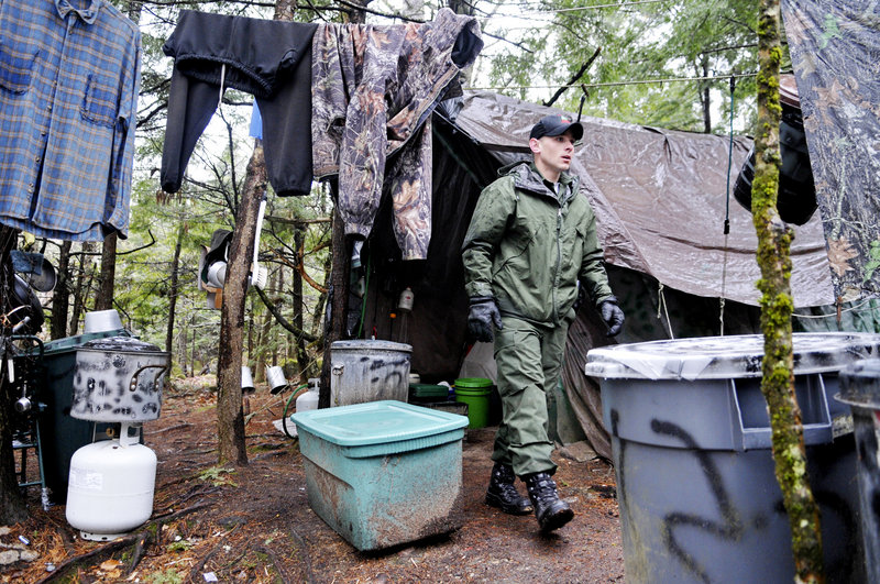 Game Warden Aaron Cross leaves Christopher T. Knight's camp April 9 in Rome. Knight is suspected of at least 1,000 camp burglaries in his nearly 30 years of living in the woods.