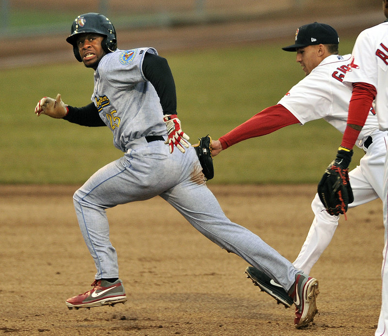 Anthony Hewitt of the Reading Fighting Phils is tagged out by second baseman Derrik Gibson of the Portland Sea Dogs after being caught in a rundown Wednesday night. The Sea Dogs won 5-2 at Hadlock.