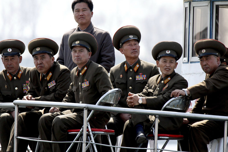 North Korean military officers ride on a sight-seeing boat on the Yalu River on the China-North Korea border on Wednesday.