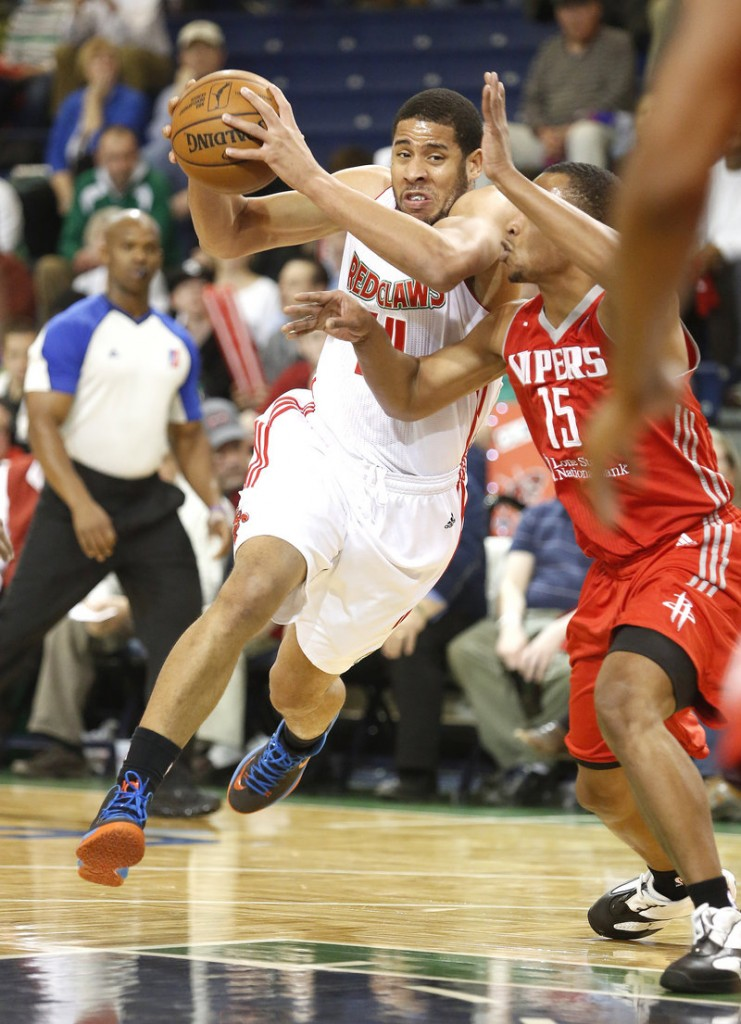Mark Tyndale of the Maine Red Claws drives past Andrew Goudelock of the Rio Grande Valley Vipers during the second quarter of Rio Grande Valley's 120-118 victory.