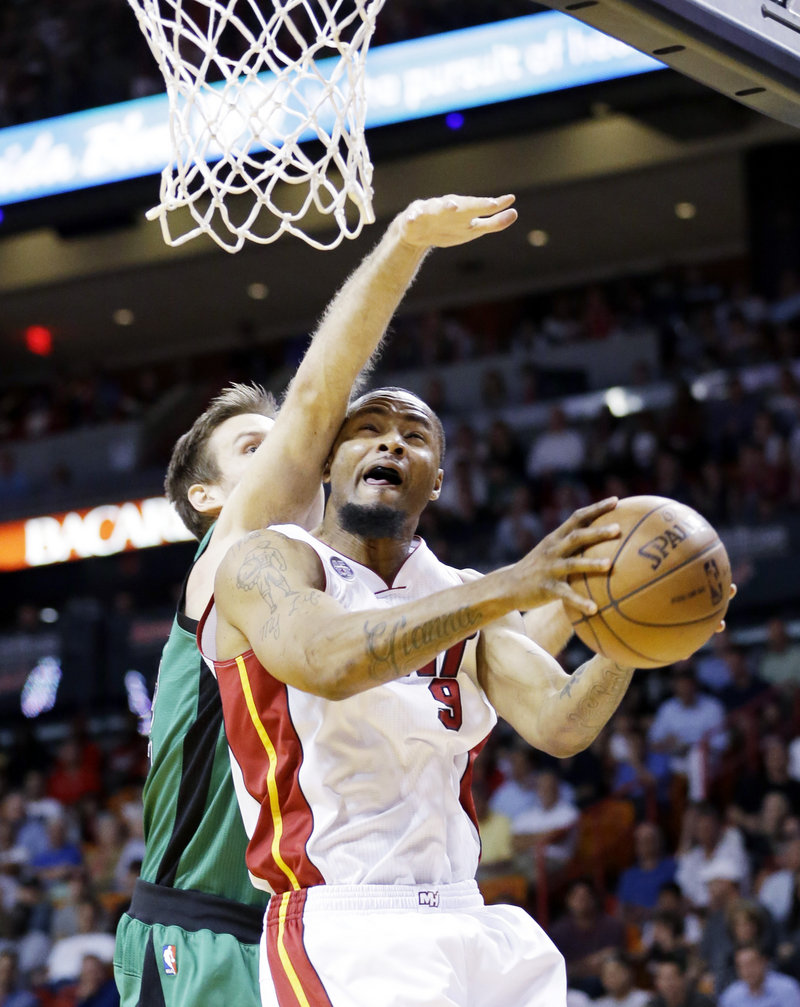 Miami Heat forward Rashard Lewis goes up for a shot against Boston Celtics forward Shavlik Randolph during the first half Friday in Miami. The Heat scored 41 points in the second quarter on the way to a 109-101 win.