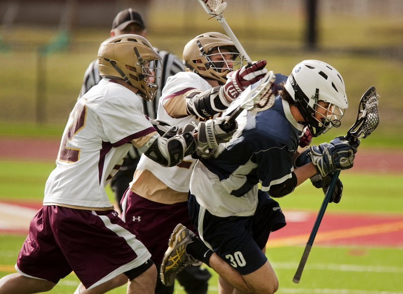 Christian Michaud, left, and Zachary Bryant of Thornton Academy put pressure on Ben Allen of Portland during their schoolboy lacrosse opener Saturday. Thornton won, 9-4.